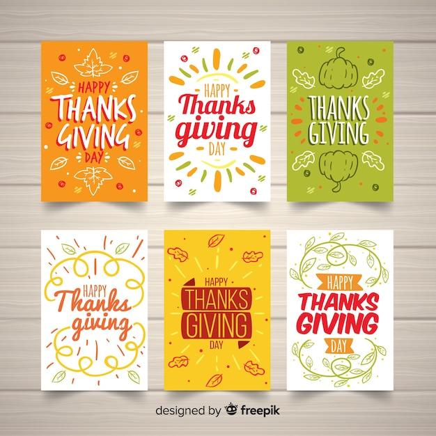 Lovely hand drawn thanksgiving card collection Free Vector