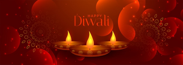 Lovely happy diwali banner with three diya lamps Free Vector