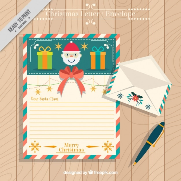 Lovely letter of santa claus with envelope and pen