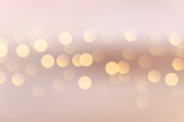 Lovely soft background with circular bokeh lights Free Vector