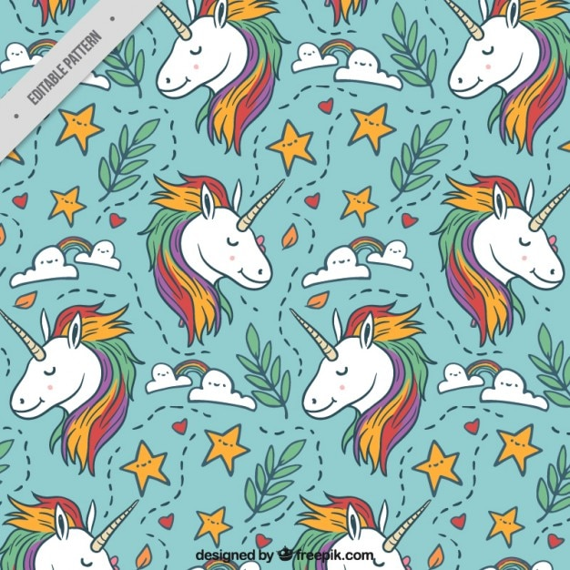 Lovely unicorn with hand drawn elements pattern Free Vector