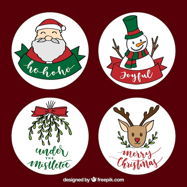 Lovely variety of hand drawn christmas labels Free Vector