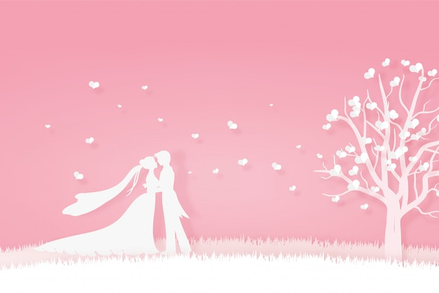Lover in wedding dress hugging on the meadow Premium Vector