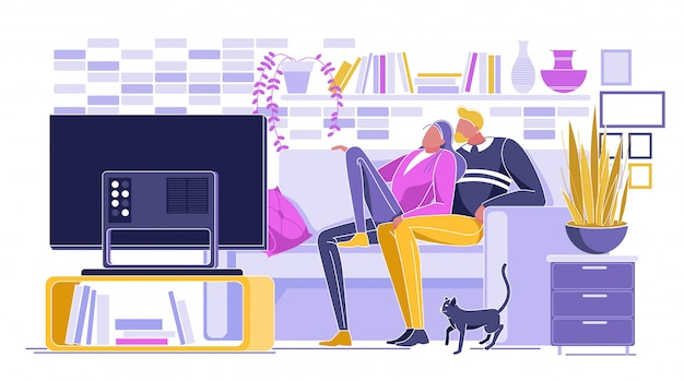 Loving couple watching film on tv set at home Premium Vector