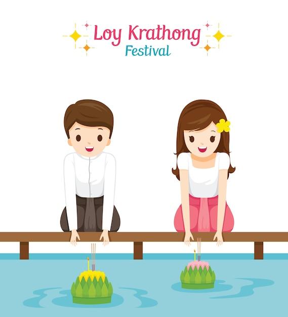ロイクラトンフェスティバル、伝統的なタイの服を着た男の子と女の子、民族衣装の着席、お祝いとタイの文化 Premiumベクター