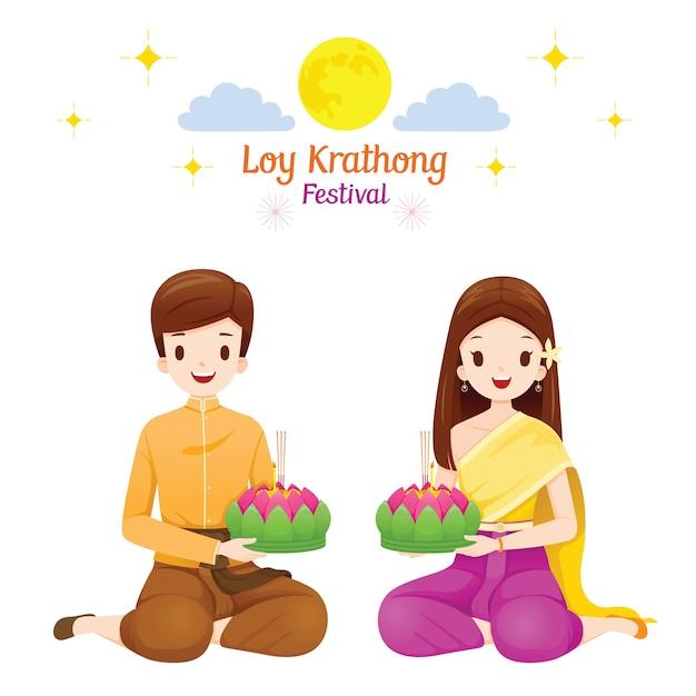ロイクラトンフェスティバル、タイの伝統的な服装のカップル、民族衣装の着席、お祝い、タイの文化 Premiumベクター