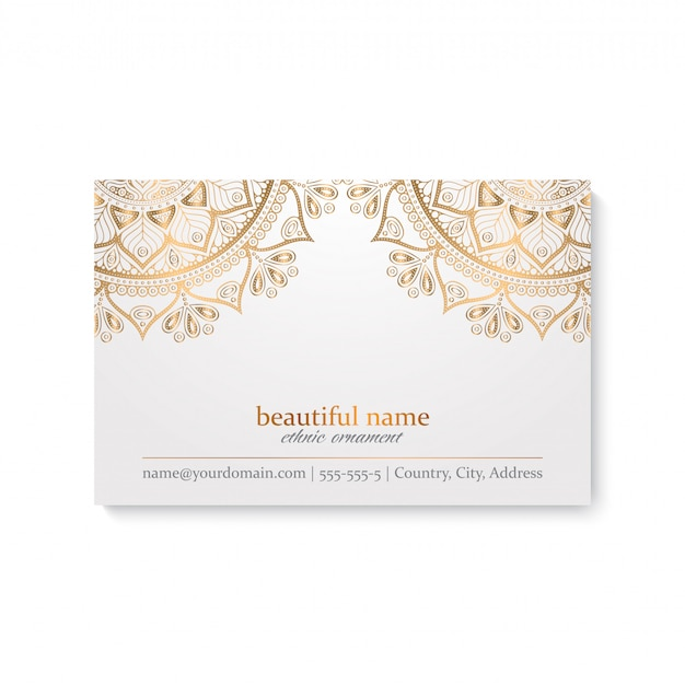 Luxury business card template with ethnic style, white and golden color Free Vector