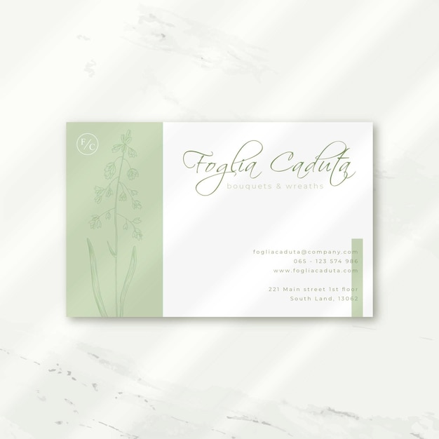 Luxury business card in white with flowers Free Vector