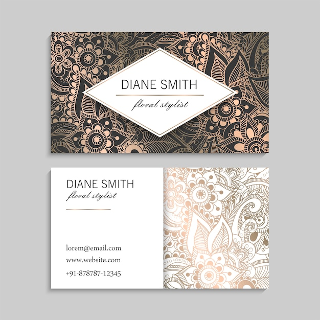 Luxury gold business card  template with with zentangle hand drawn flowers Free Vector