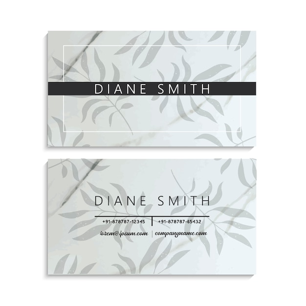 Luxury marble business card template with tropical leaves. Free Vector