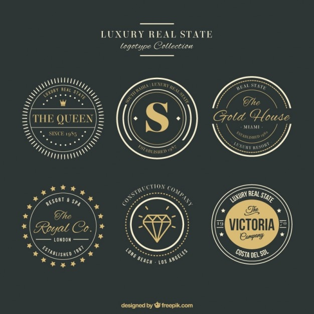 Luxury real estate logos with golden details Free Vector