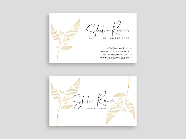 Luxury white business card with floral pattern Premium Vector