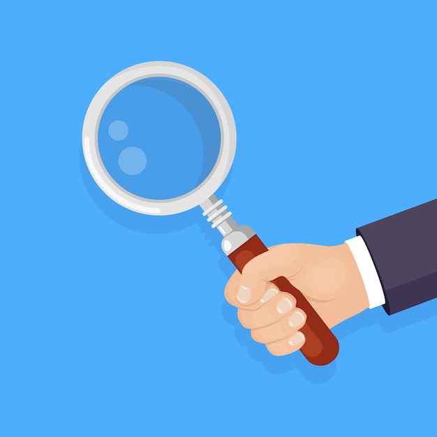 Magnifying glass, loupe in hand isolated on background. business man hold magnify Premium Vector