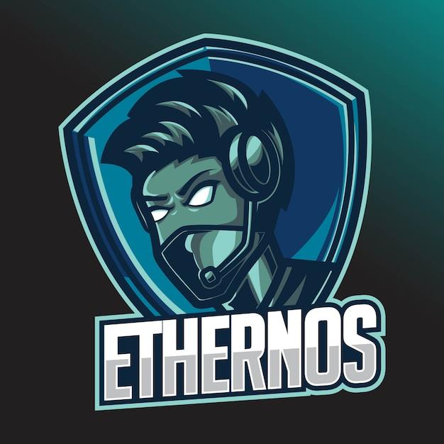 Male gamer e-sport logo design template with headphone Premium Vector