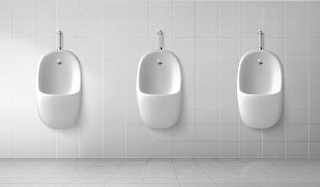 Интерьер мужского туалета с рядом белых писсуаров Бесплатные векторы