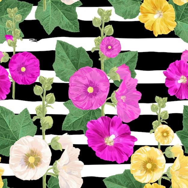Malva flower seamless pattern. summer floral background with flowers. Premium Vector