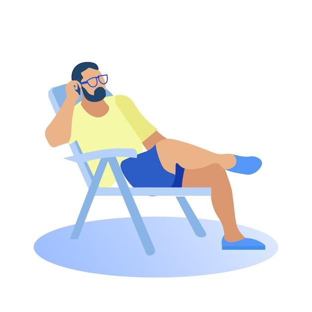 Man in beachwear sits on chair talking on phone. Premium Vector