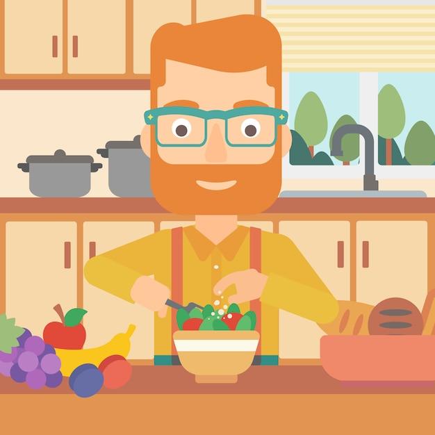 Man cooking vegetable salad. Premium Vector