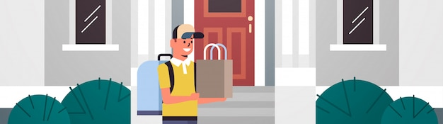 Man courier in cap carrying fast food order guy with backpack and paper package products express delivery from shop or restaurant concept modern house building exterior flat horizontal portrait Premium Vector