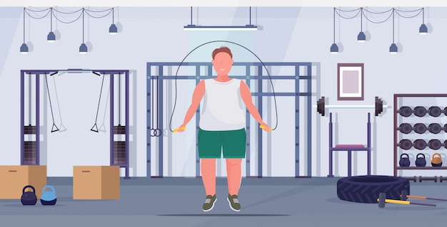 Man doing exercises with jumping rope overweight guy training workout weight loss concept modern gym health club studio interior flat full length horizontal Premium Vector