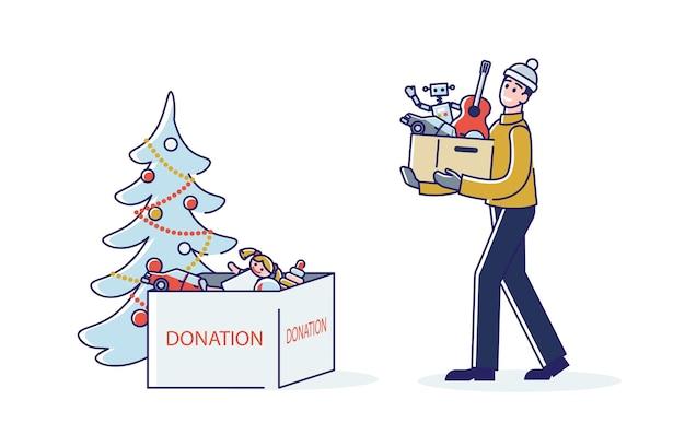 Мужчина жертвует игрушки на рождественскую благотворительную акцию Premium векторы
