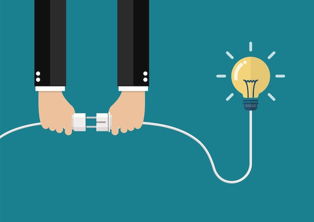 Man holding in hand plug and socket to connect an idea Premium Vector
