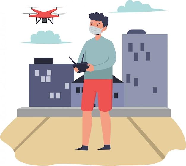 Человек играет дрон снаружи при использовании медицинской маски Premium векторы