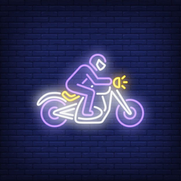 Man riding motorcycle on brick background. neon style Free Vector