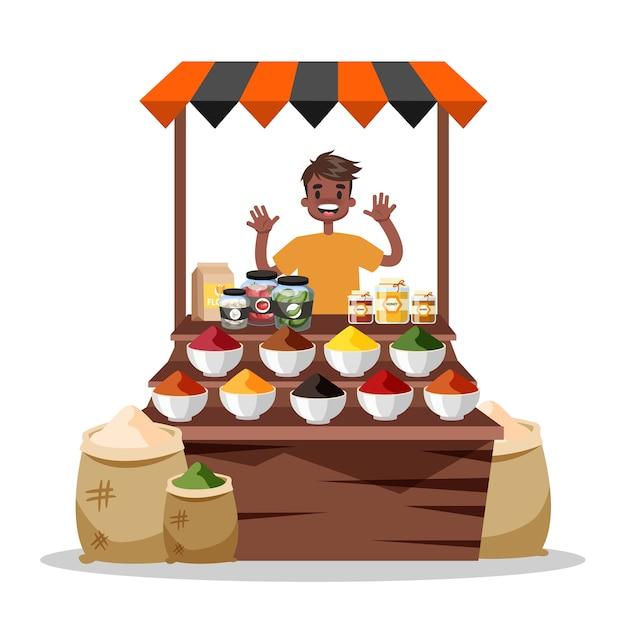 食品のスパイスを売る男。アジアのカラフルなスパイス市場 Premiumベクター