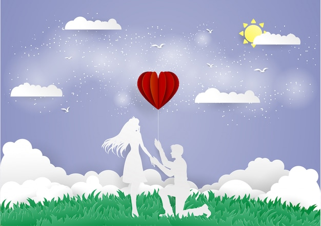 Man staying on the knee and givel red heart balloon Premium Vector