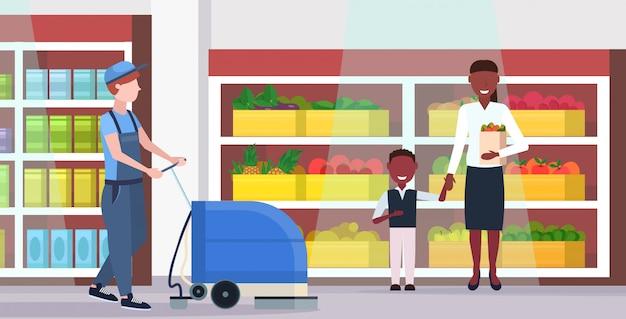 均一なクリーニングサービスフロアケアコンセプトモダンな食料品店のインテリアフラット全長水平でプロの洗濯機男性クリーナースーパーマーケット管理人を使用している人 Premiumベクター