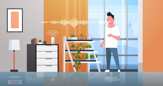 Man using smart speaker voice recognition activated digital assistants concept auto watering system modern living room interior flat horizontal full length Premium Vector