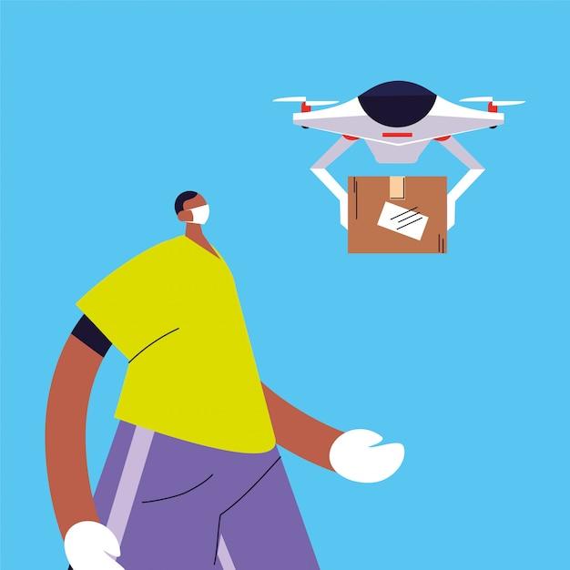 Мужчина с дроном несет картонную коробку Premium векторы
