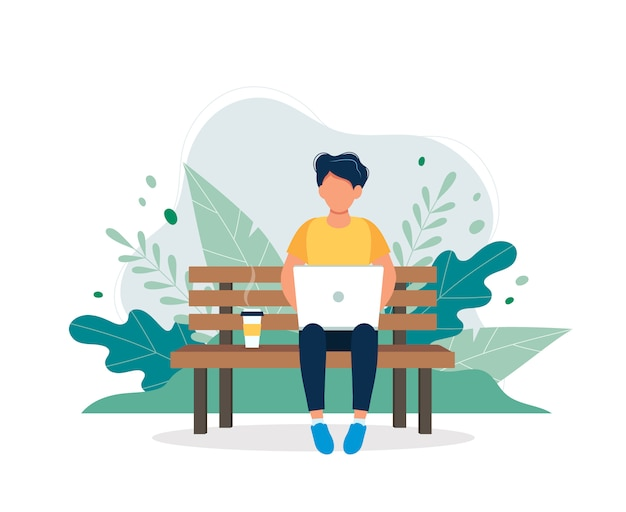 Man with laptop sitting on the bench in nature and leaves. Premium Vector