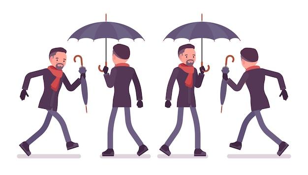 秋の服のイラストを着て歩いて走る傘を持つ男 Premiumベクター