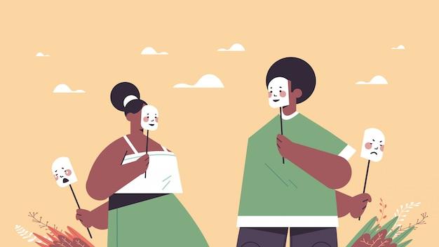 男性女性はマスクの下で自分の感情を隠す偽の精神障害 Premiumベクター