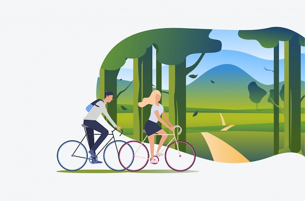 Man and woman riding bicycles with green landscape in background Free Vector