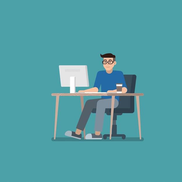 Man working on desktop computer Premium Vector