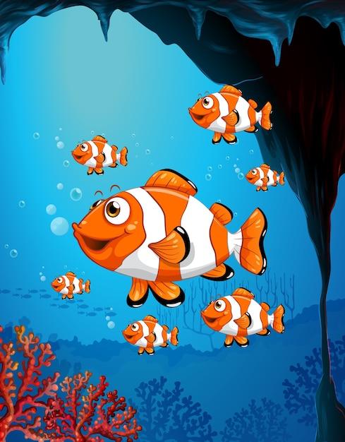 サンゴと水中シーンで多くのエキゾチックな魚の漫画のキャラクター 無料ベクター