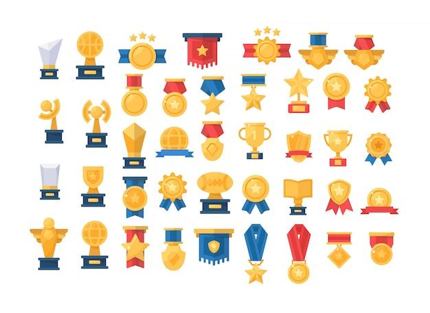 Medal, trophy, golden cups for winners Premium Vector