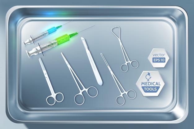 金属製滅菌器の図にある現実的な注射器鉗子メスはさみと医療ツール Premiumベクター