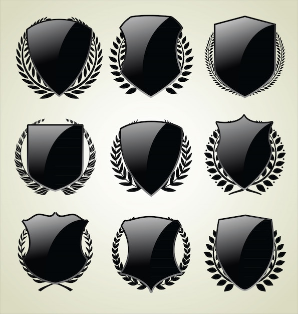 Medieval shields and laurel wreath collection Premium Vector