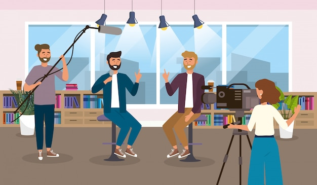 Men reporter in the studio and  camera woman with camcorder equipment Premium Vector