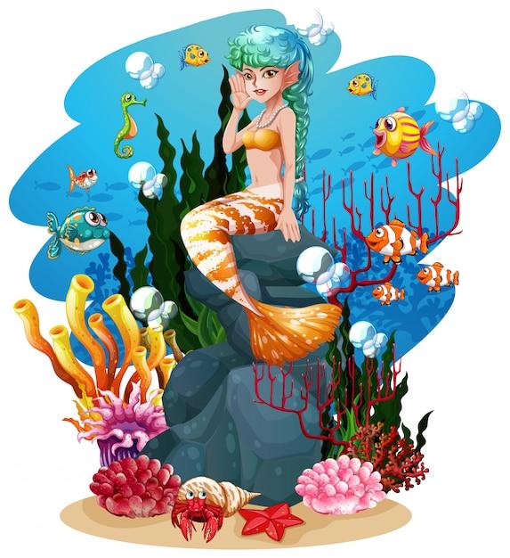 Mermaid and fish under the sea Premium Vector