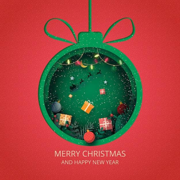 Веселого рождества и счастливого нового года. зеленый елочный шар украшен подарочной коробкой и санта-клаусом в санях. Premium векторы