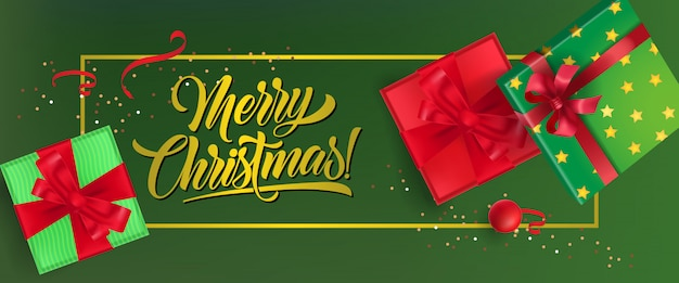Merry christmas banner design. gift boxes with ribbons Free Vector