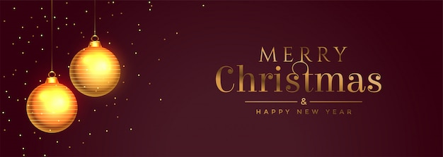 Merry christmas banner with golden ball and sparkles Free Vector