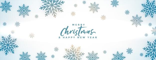 冬の雪片とメリークリスマスバナー 無料ベクター