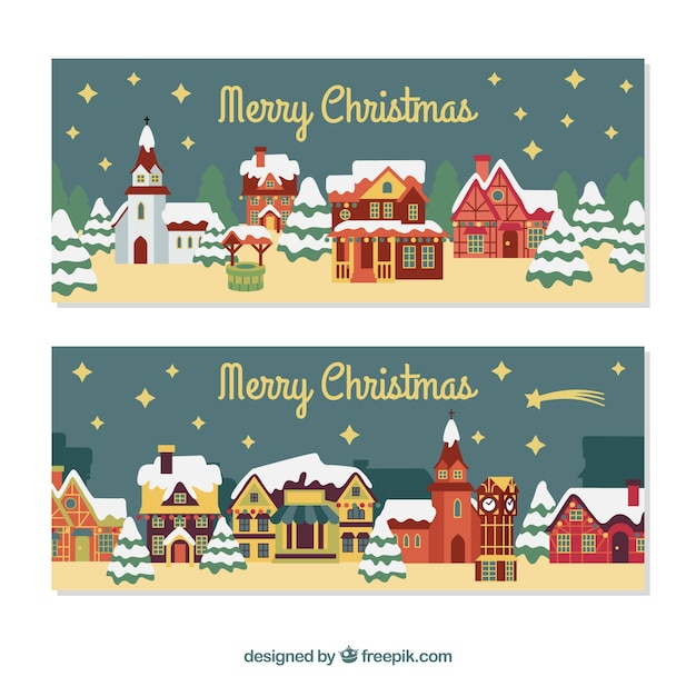 Merry christmas banners with nice houses Free Vector