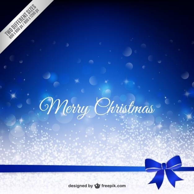 С рождеством боке фон с синим бантом Бесплатные векторы
